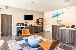 Here is the lobby at Signature hotel. Free continental breakfast, table and chairs. Coffee in the morning for our guests.
